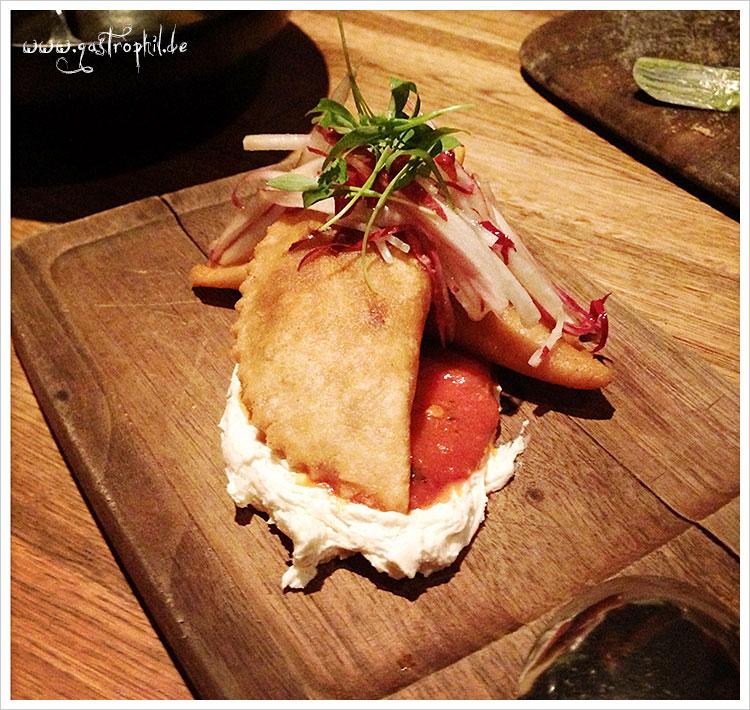 Goat empanadas, romesco, radish-endive slaw