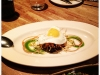 Wood oven roasted pig face, sunny side egg, tamarind, cilantro, red wine-maple, potato stix